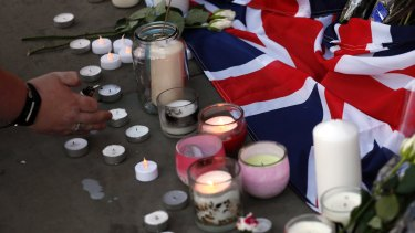Flowers and candles are seen after a vigil in Albert Square, Manchester, England.