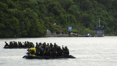 Indonesian military training takes place in front of Nusakambangan Prison where Australians Andrew Chan and Myuran Sukumaran are awaiting execution.