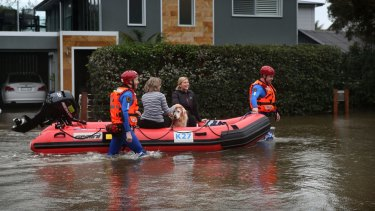 Residents evacuate their homes  as rising waters inundate Narrabeen Street, Narrabeen.