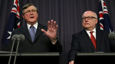 David Irvine (left), head of ASIO, and George Brandis both want metadata stored for fighting terrorism and crime.
