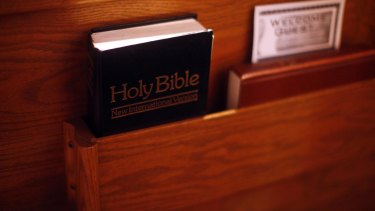 A bible in the pew at a church in Des Moines, Iowa, on Dec. 11, 2011. Conservative Christian voters in Iowa cannot agree on which Republican presidential candidate to support, finding faults based on principle or electability. (Eric Thayer/The New York Times)