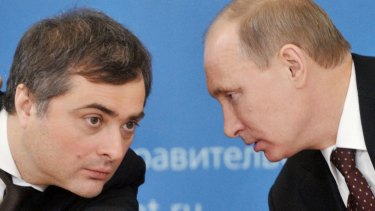 Russian Prime Minister Vladimir Putin, right, speaks to Vladislav Surkov, then-deputy prime minister in charge of economic modernisation.