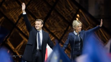 Emmanuel Macron, French presidential candidate, and his wife wife Brigitte Trogneux, wave after delivering a speech in front of the Pyramid at the Louvre Museum in Paris.