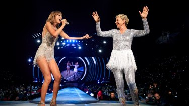 Taylor Swift with comedian Ellen DeGeneres onstage during Taylor Swift's Los Angeles show in August.