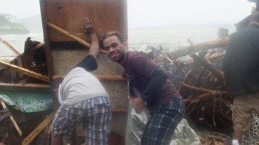 Port Vila residents survey the damage.