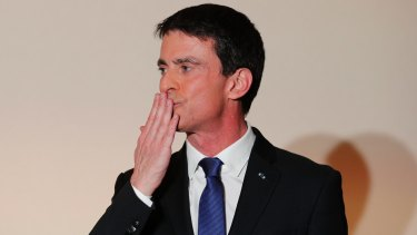 Former socialist Prime Minister Manuel Valls blows a kiss to supporters after conceding defeat.
