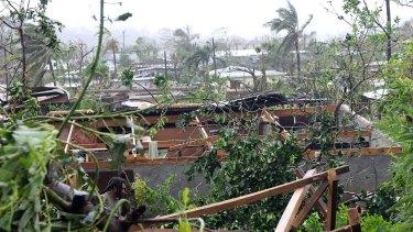 Buildings shorn of their roofs in Port Vila, Vanuatu's capital.
