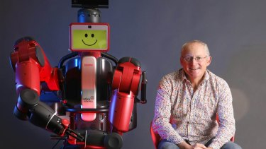 University of NSW professor Toby Walsh with the robot Baxter.