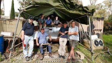 The team restoring the tank (clockwise from front left): Paul Martyn-Jones, Dave Crisp, Joe Tabone, Mike McGraw, Ian Hawthorn, Ray Jones and George Glass.