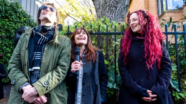 L-R: Brother Harry Howard, partner Genevieve McGuckin and sister Angela Howard speaking at the unveiling of Rowland S Howard laneway in St Kilda.