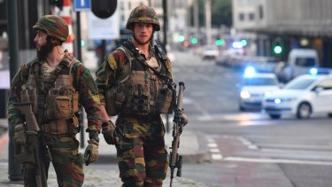 Belgian Army soldiers patrol outside Central Station after a reported explosion in Brussels on Tuesday.
