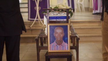A portrait of Egide Niyongere displayed in front of his coffin during his funeral earlier this month.