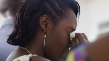 "A young woman wipes tears off her face during the funeral of Egide Niyongere in Burundi earlier this month. He was one of those killed during a ""search operation"" carried out by the Burundian police."