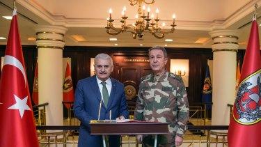 Turkey's Prime Minister Binali Yildirim, left, and Chief of Staff General Hulusi Akar.