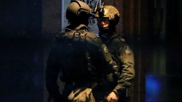 NSW Tactical Operations officers at the scene of the siege on Monday night.