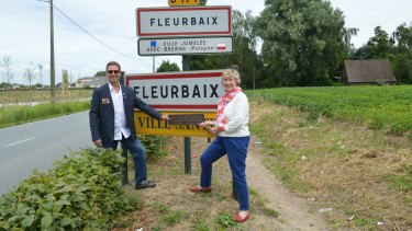 """Victor Offe's grandchildren, Paul Fullston and Victoria Petho, return their grandfather's """"Fleurbaix"""" sign to the Western Front, 100 years on."""