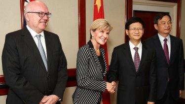 Attorney-General George Brandis, Foreign Minister Julie Bishop and Chinese Central Commission on Political and Legal Affairs, Secretary Meng Jianzhu.