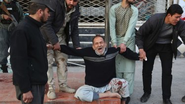 A relative of a victim is cries after a deadly suicide attack in Kabul, Afghanistan.