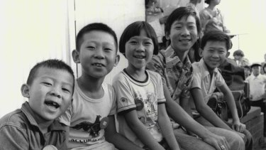 February 1977: Laotians celebrate their arrival at Villawood after leaving a refugee camp in Thailand.