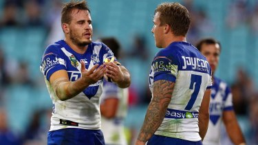 Gone to the dogs: Josh Reynolds and Trent Hodkinson have words during the Canterbury's loss to Wests Tigers on Friday night.