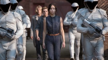 Jennifer Lawrence takes the totalitarian nightmare movie into new, feminine territory in <i>The Hunger Games</i>.