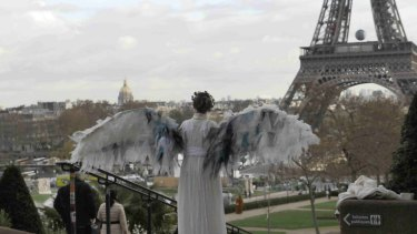 Winged protest: Australian art activists Climate Guardian Angels are hoping to get around the post-terror ban on protests in Paris.