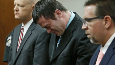 Daniel Holtzclaw cries as he stands in front of the judge after the verdicts were read out.
