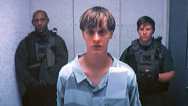Dylann Roof appears by closed-circuit television at his bond hearing in Charleston, South Carolina.