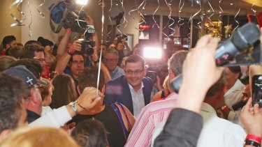 Labor supporter surround Daniel Andrews as he moves to the stage to make his victory speech.