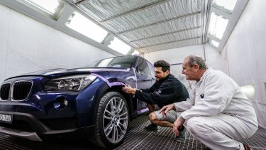 Apprentice spray painter Salvatore Acconcio (left) and his boss Peter Fitzhenry.