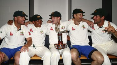 Happy bunch: (from left) David Warner, Usman Khawaja, Steve Smith, Adam Voges and Joe Burns celebrate with the Trans-Tasman Trophy.