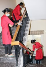 Maids being trained by GDH Workforce, an agency in Hyderabad, on how to clean kitchens and bathrooms and how to use a vacuum cleaner.