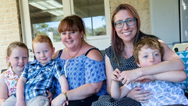 Dionne Barton (left), with Lawrence, 5, and Georgia, 7, and Claire Ormiston, with Samuel, 4, have concerns about Kids Academy Hornsby.