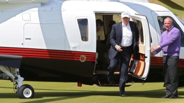 Donald Trump arrives at the Trump International Golf Links course at Balmedie.