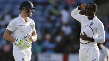 West Indies' Marlon Samuels salutes England's Ben Stokes.