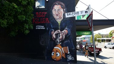 Queensland Premier Annastacia Palaszczuk depicted holding a gun to Nemo's head in an anti-Adani street mural in New Farm.