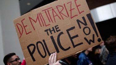 """Critical crowd: Demonstrators take part in a protest outside the Office of Police Complaints as part of a planned """"28 Hours for Mike Brown"""" protest in Washington, DC."""