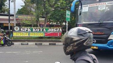 Indonesian crackdown: banner reads 'Reject communist ideology'.
