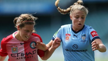 Stalemate: Remy Siemsen of Sydney, right, is challenged by City's Rebekah Stott.