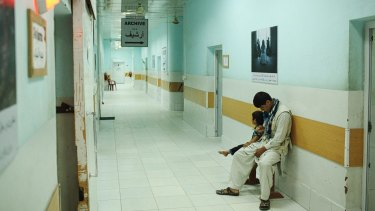 a child waits for an X-ray with her father at Kunduz's hospital before the bombing.