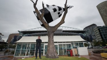 Sculptor John Kelly and his cow in a tree, which is now surrounded by a popup cafe, concrete planter boxes, wooden seating, a tree in a pot and even an outdoor ping-pong table.