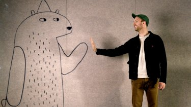 Children's book author-illustrator Jon Klassen with his creation from <i>I Want My Hat Back</I>.