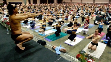 Bikram Choudhury, front, teaches a hot yoga class in the Los Angeles Convention Centre in 2003.