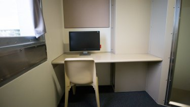 The cell comes with a desk and computer screen but no internet access.