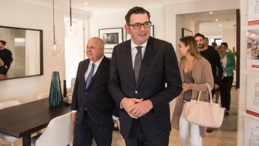Premier Daniel Andrews with Treasurer Tim Pallas meeting first home buyers Polly Pleban and Tom Quick.