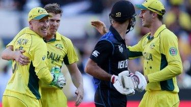 Australia's players look on as Grant Elliott departs.