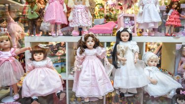 A collection of the beautifully dressed dolls in the Block Arcade window.