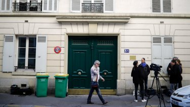 The entrance of the Paris apartment building where police found an explosive device.