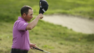 Chez Reavie tips his cap after finishing play on the 18th.