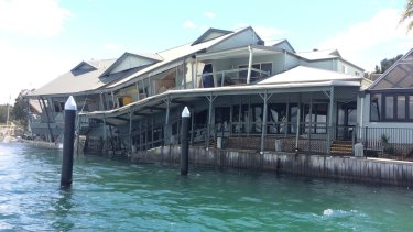 Restaurant Milanos On The Lake has partially collapsed into Lake Macquarie.